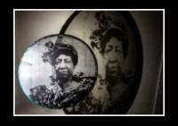 """ELIDIA, Cantadora and head of the group. Bahia Solano, Chocó , Colombia. handprinted on organza, mounted on hoop with african fabric. 8"""""""